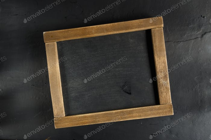 Chalk board with space for text.