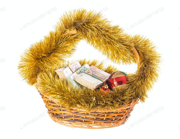 Christmas wicker basket full of euro bills.