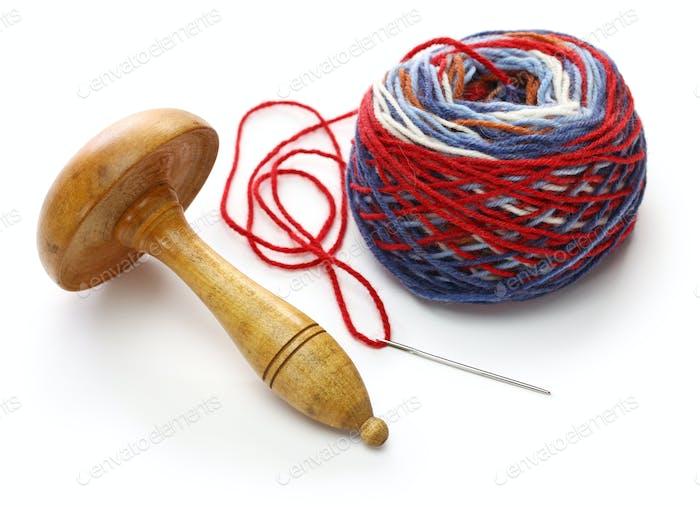darning mushroom, yarn ball and needle