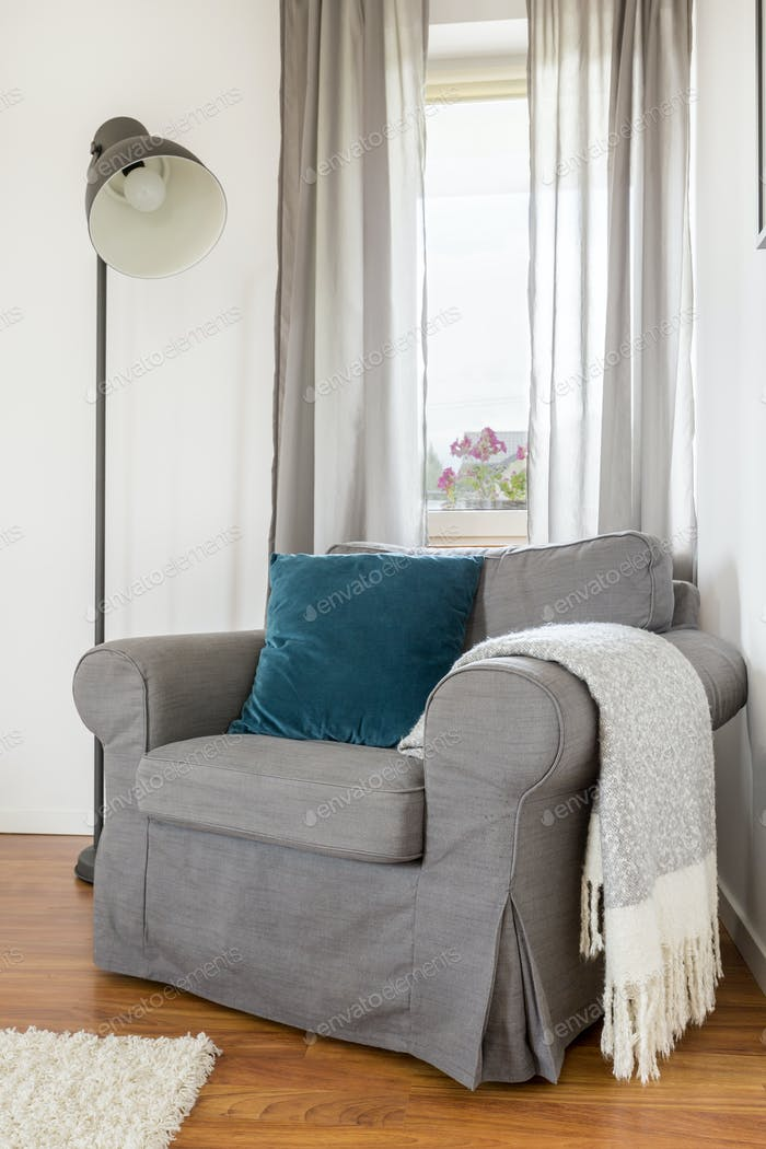 Room with grey armchair