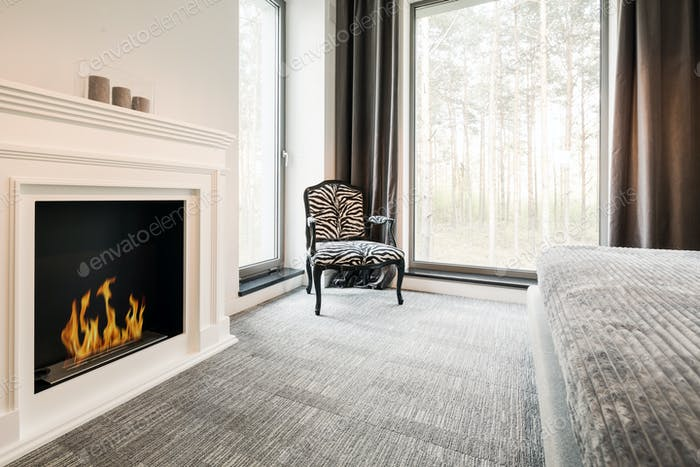 Grey bedroom with elegant fireplace
