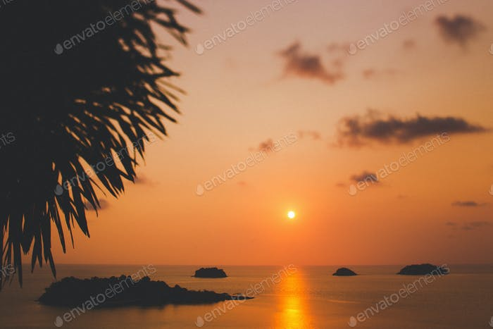 Amazing colorful red sunset at tropical islands. Silhouettes in sunlight, space fot text