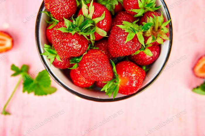 Strawberries in red bowl. Fresh strawberries. Beautiful strawberries.