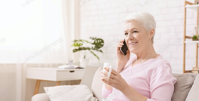 Lovely senior lady having fun conversation with her friend