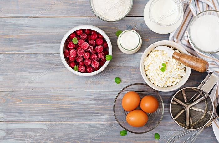 Ingredients for the preparation of cottage cheese casserole with cherries. Tasty breakfast. Top view