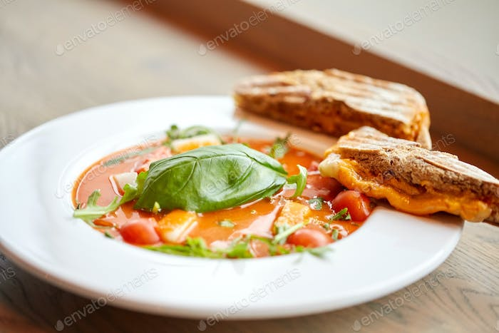 close up of gazpacho soup with bread at restaurant