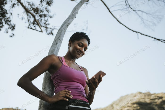 Cheerful woman using mobile phone