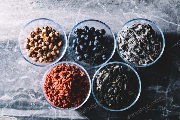 Five bowls of colorful healthy snacks