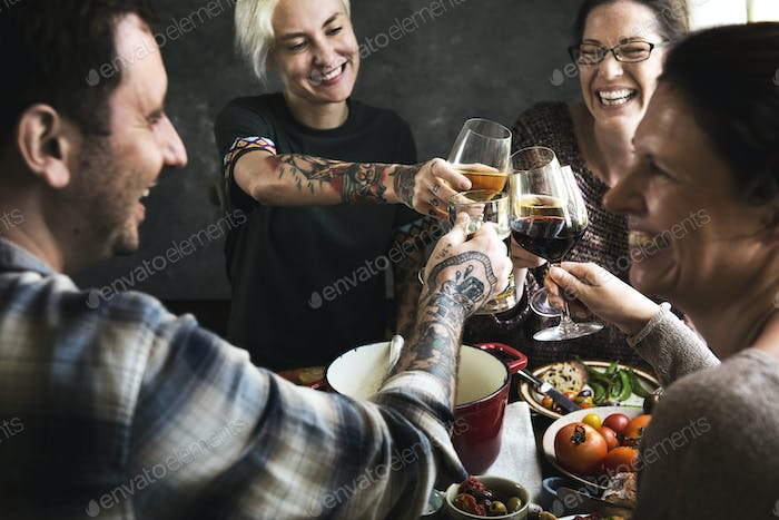 Happy people cheering with glasses of wine