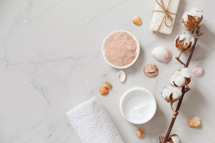 Spa cosmetics set on white marble background from above. Beauty blogger concept. Copy space