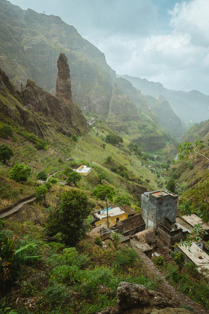 Picturesque canyon Ribeira da Torre covered with lush vegetation. Cultivation on steep terraced
