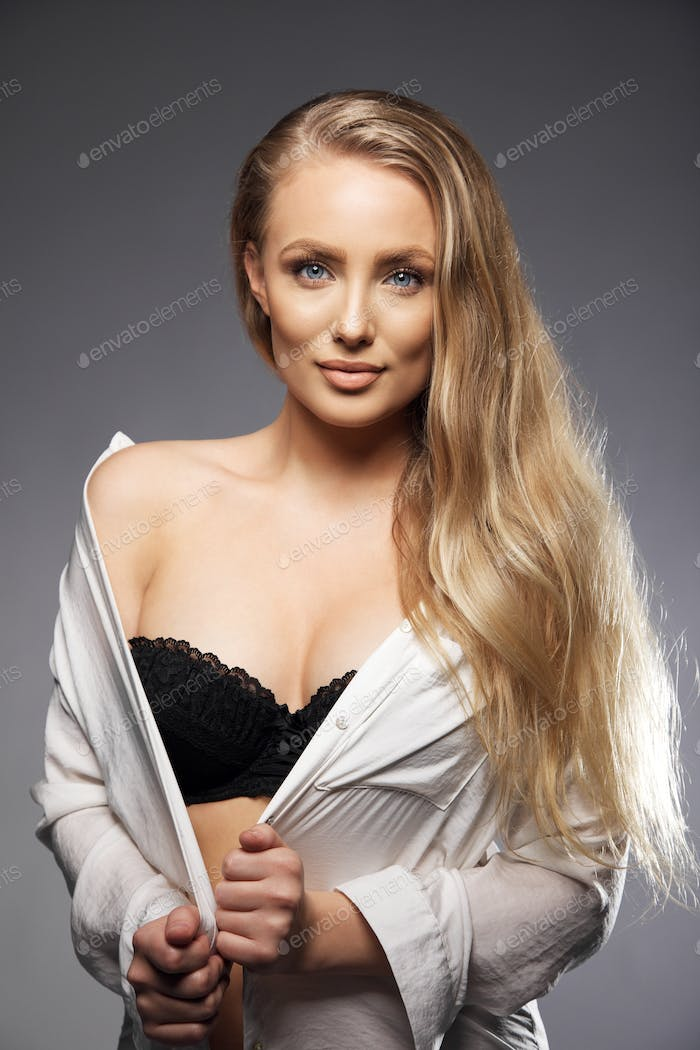 Elegant young woman wearing black lingerie