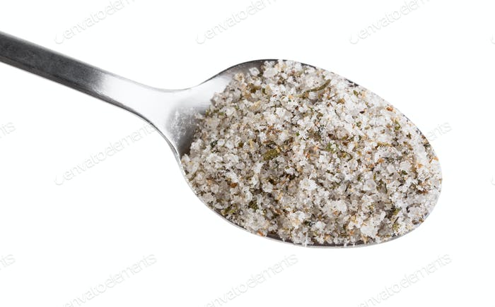 top view steel spoon with seasoned salt close up