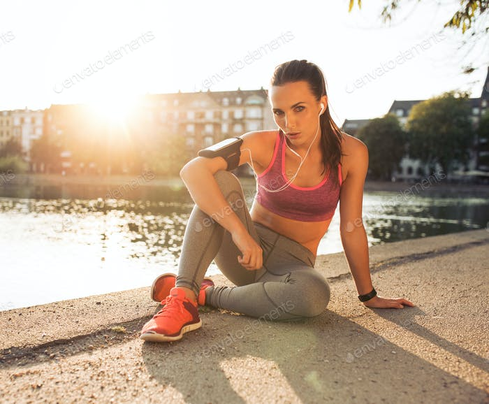 Female runner taking a rest from training