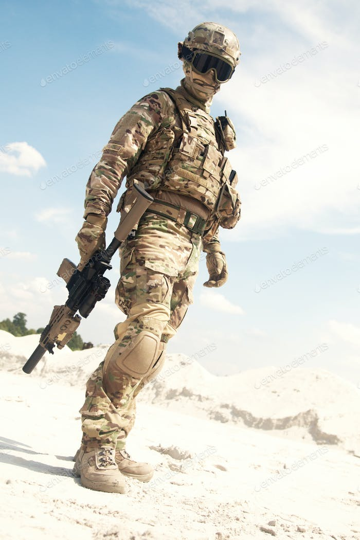 War games player equipped with tactical ammunition