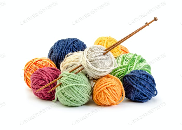 Colorful balls of yarn and wooden needles