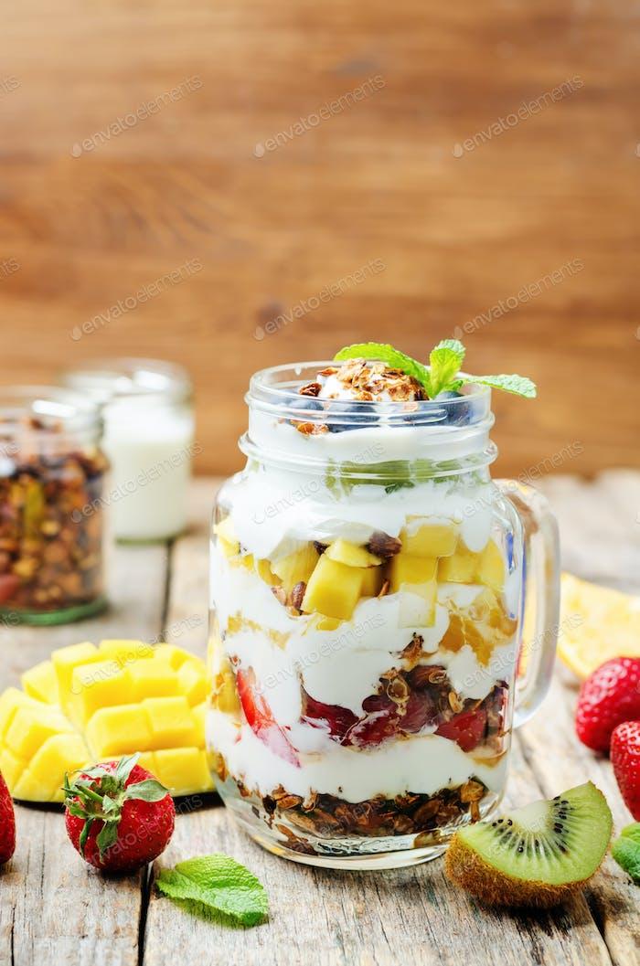 strawberry, mango, kiwi, blueberry, orange with Greek yogurt and
