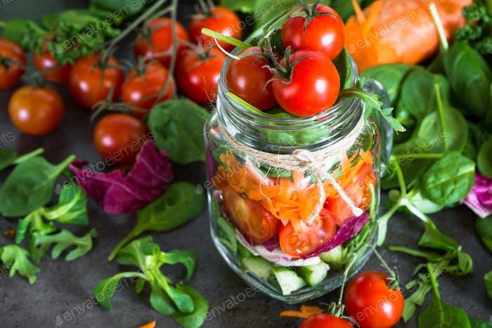 Fresh vegetarian salad in mason jar.
