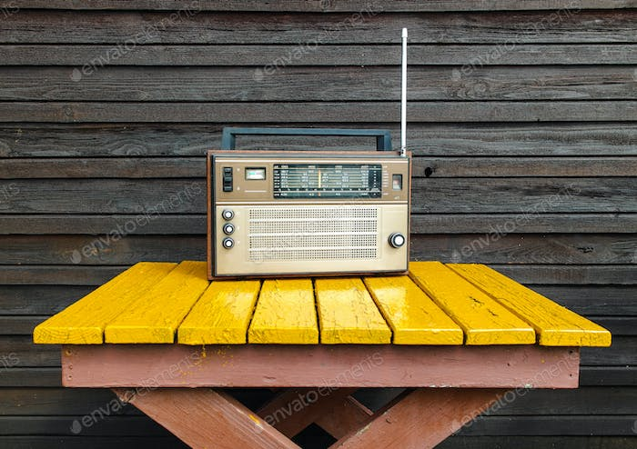 Old radio on yellow table