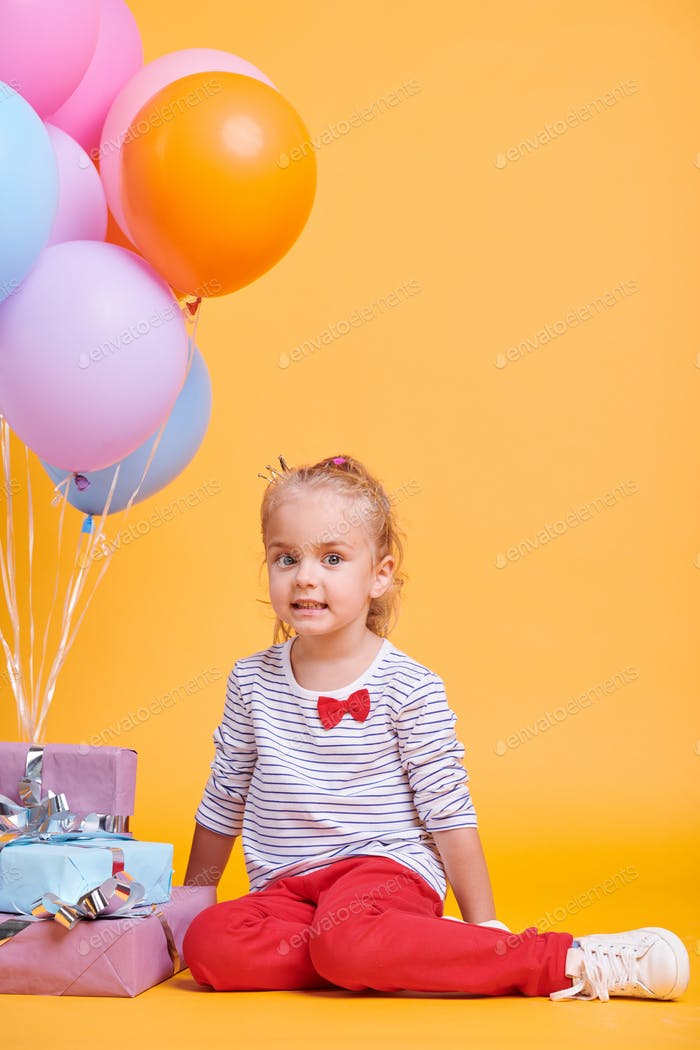 Girl with balloons and gifts