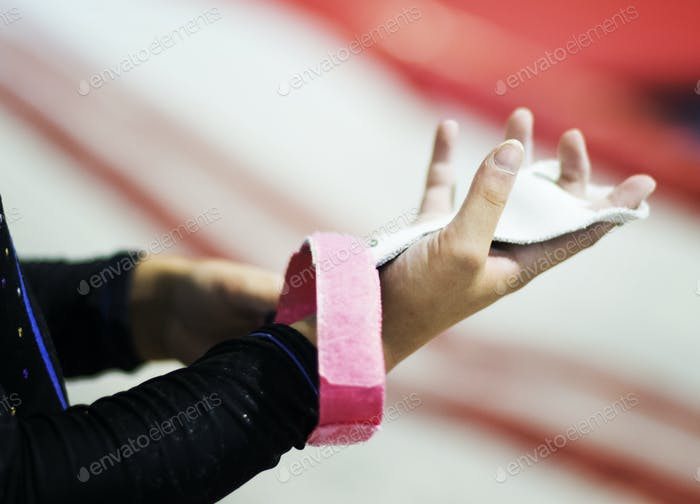 Young gymnast wearing a grip bar to her palm