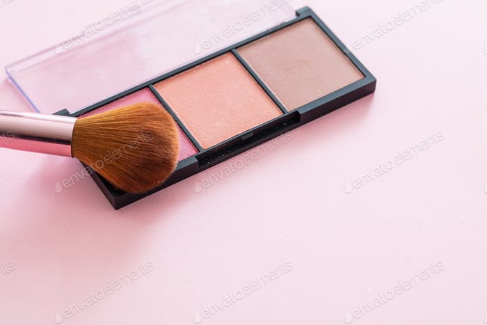Blush compact pallete kit against pink background, copy space
