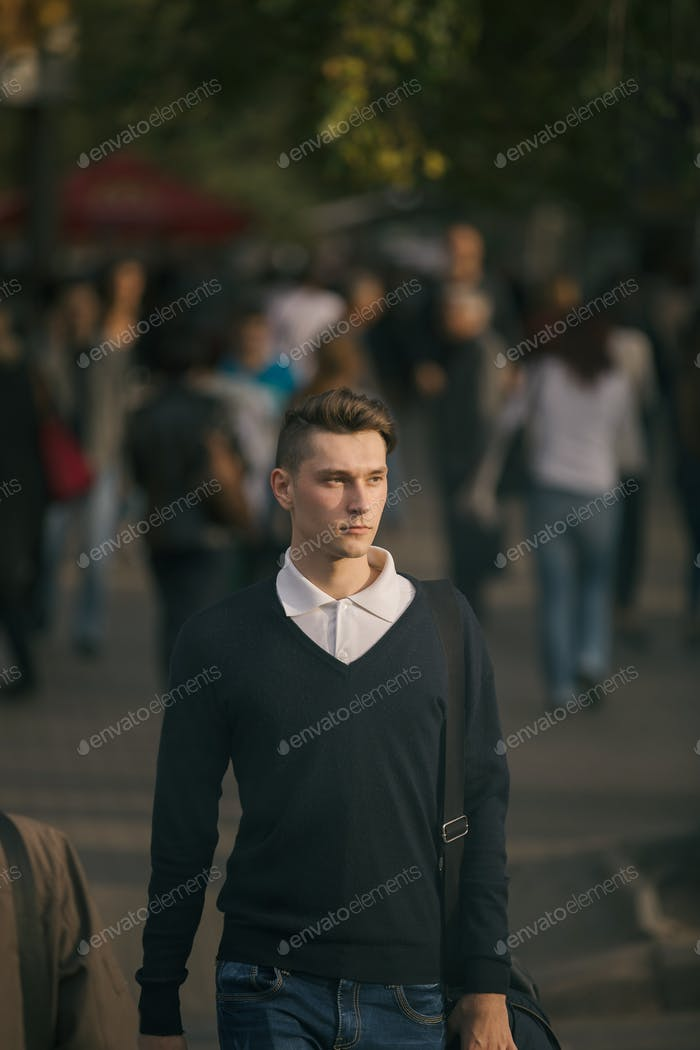 Hipster guy walking down the street, urban style