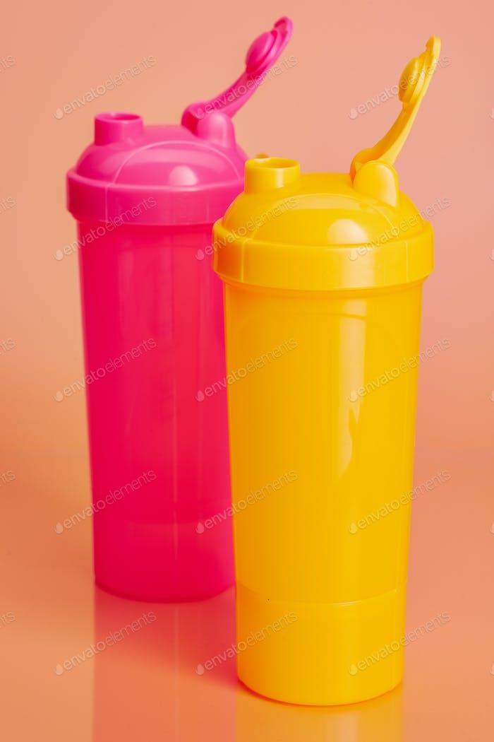 Plastic water bottles on a pastel beige background