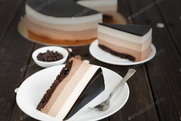 Triple chocolate layer mousse cake with glaze