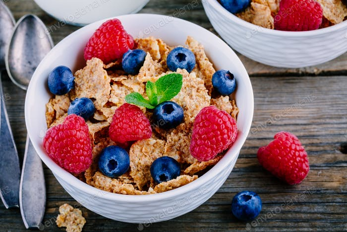 A healthy breakfast bowl. Whole grain cereal with fresh blueberries and raspberries
