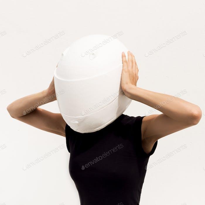 Model in the helmet. Minimal art fashion.