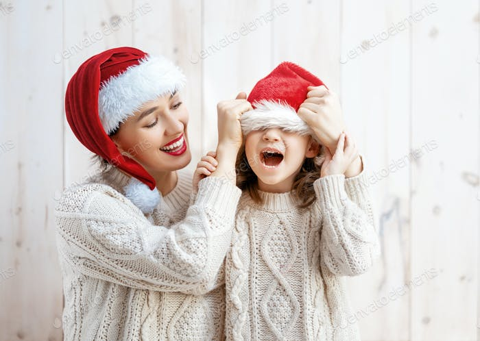 girl and her mother in Santa's hats