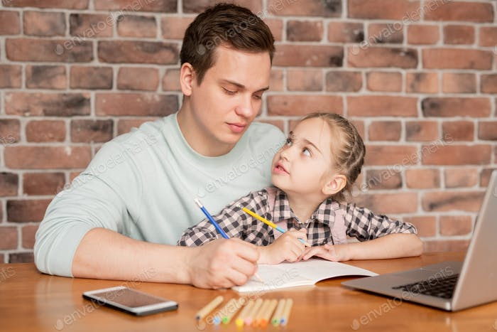 Dad drawing with daughter
