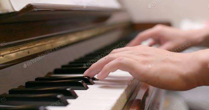 Man playing piano at home