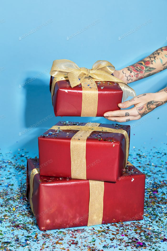 Red gift boxes with confetti