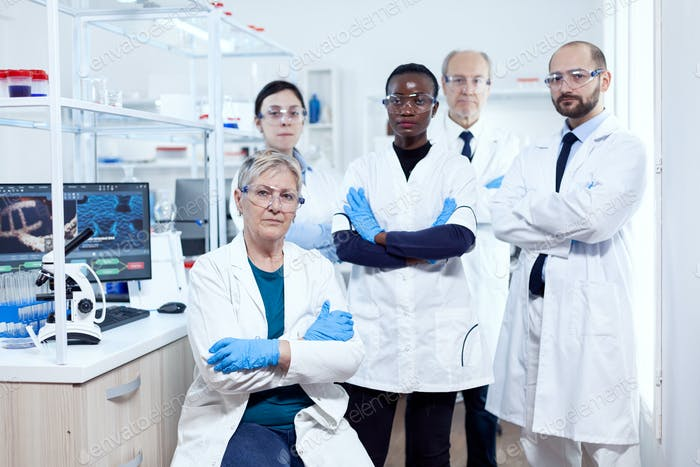 Healthcare researcher at workplace standing together