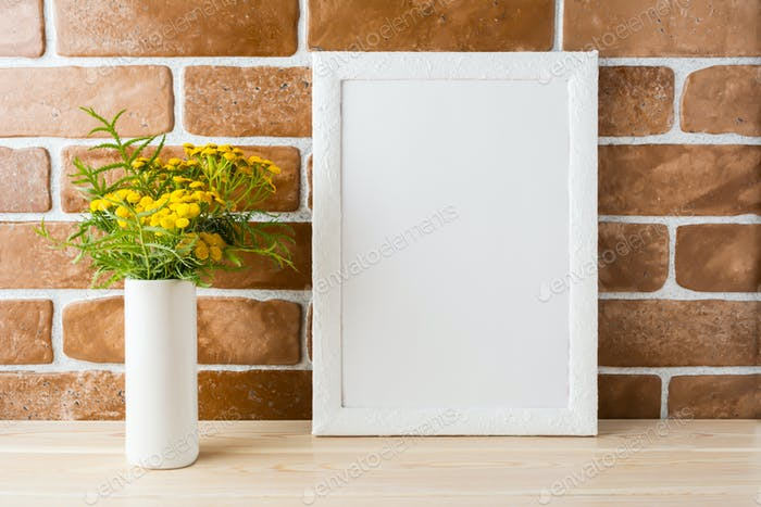White frame mockup with yellow flowers near exposed brick walls