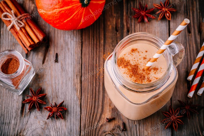 Pumpkin pie smoothie with cinnamon in mason jar