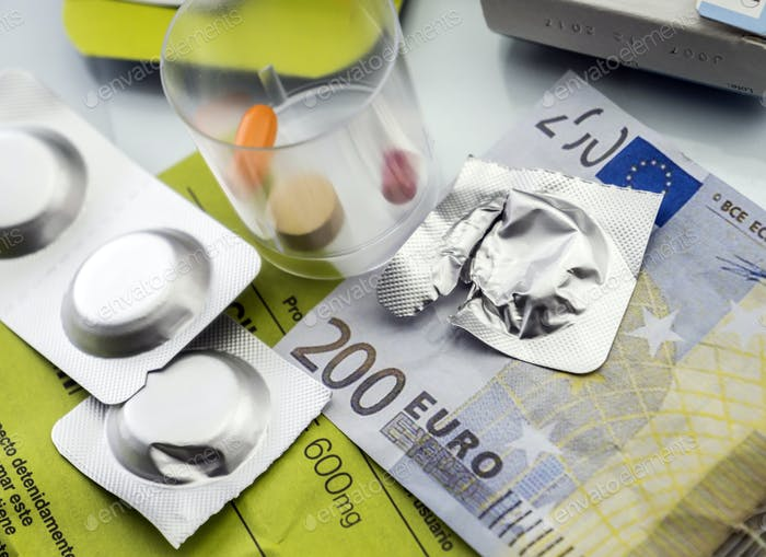 Pastilla effervescent next to medication daily on a ticket of 200 euros, concept of copayment health