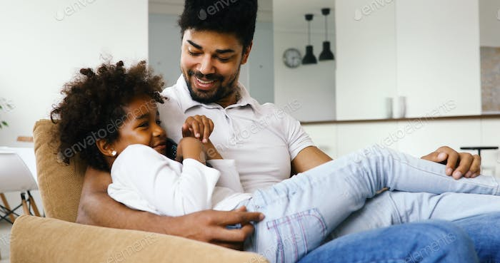 Relaxed african american family watching tv