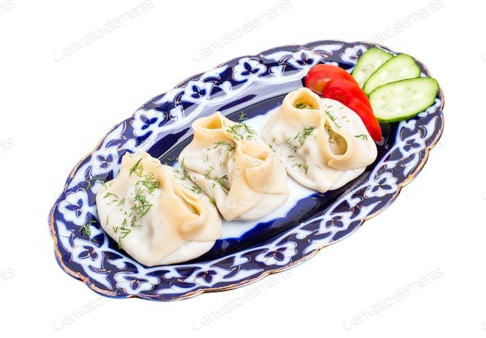 Traditional uzbek manty dumplings with lamb.
