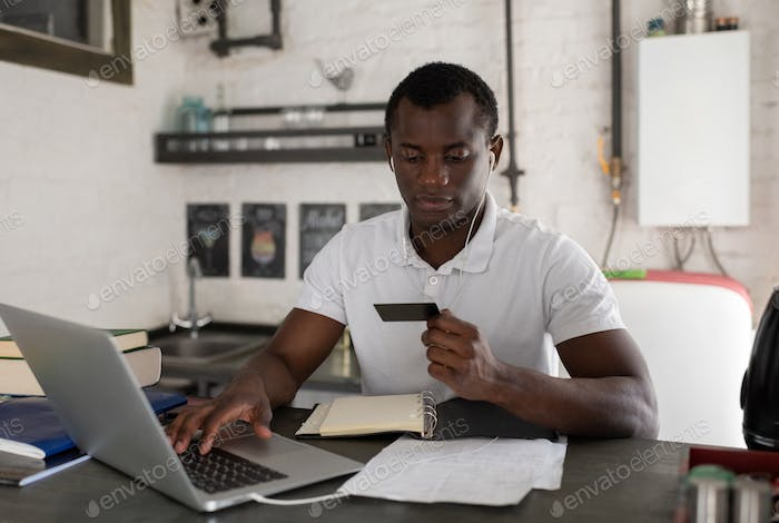 Ethnic student paying for order online