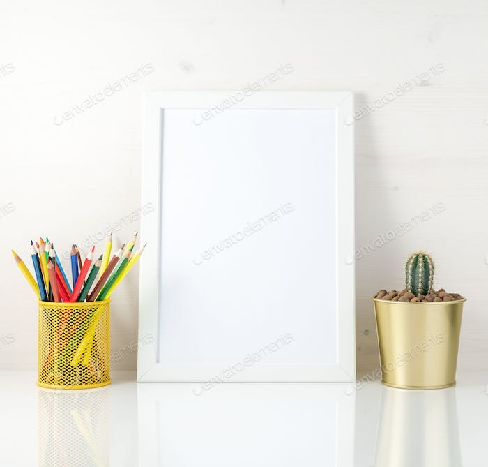Mockup with clean white frame, colored pencils and succulent