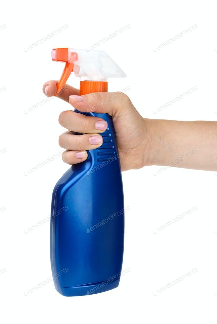 Hand holding blue sprayer bottle