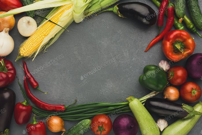 Frame of fresh vegetables on grey background with copy space