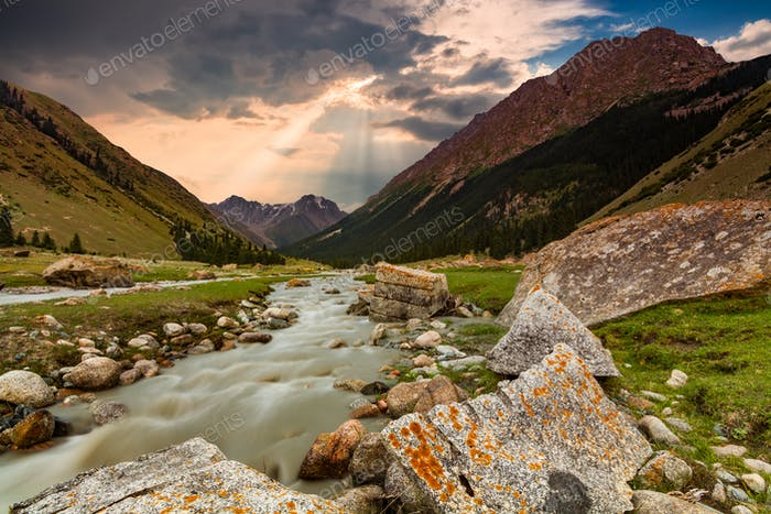 Mountain river in the gorge at sunset. Alpine landscape