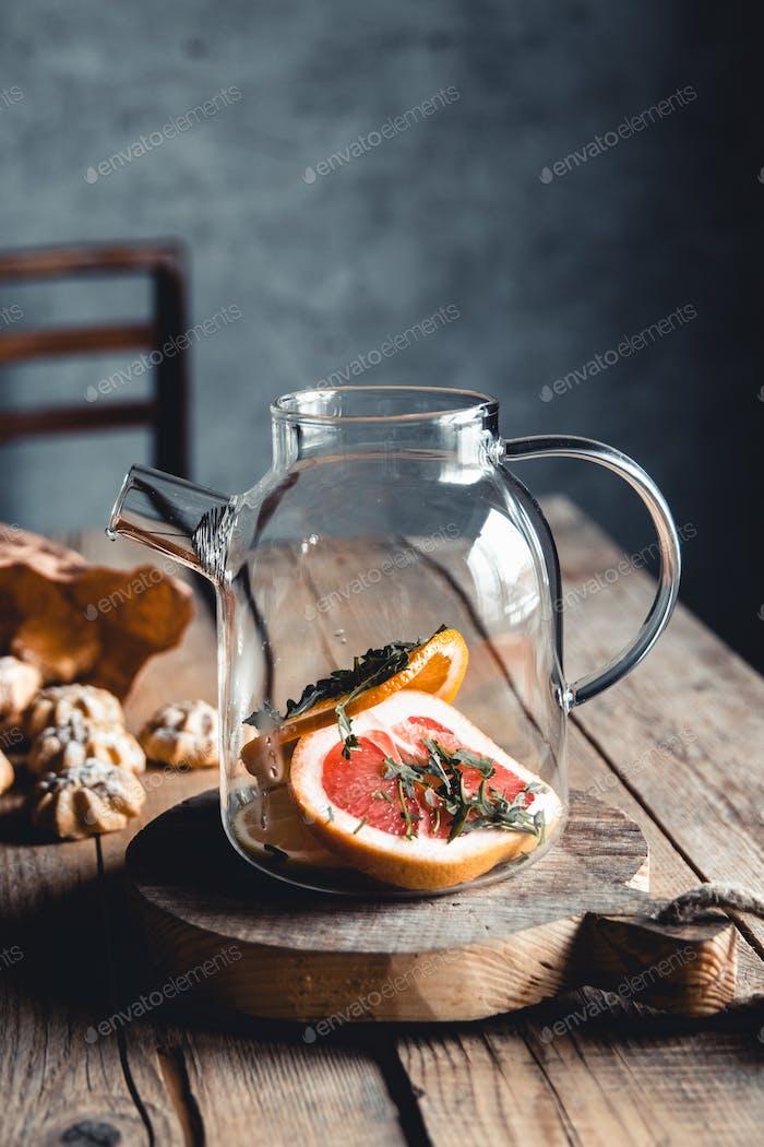 Hot tea with slices of fresh grapefruit on wooden tablet. Healthy drink, Eco, vegan