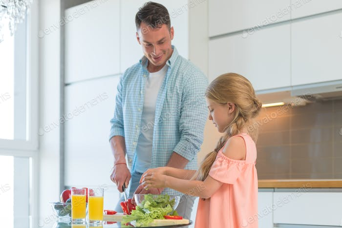 Smiling family with a child in the kitchen
