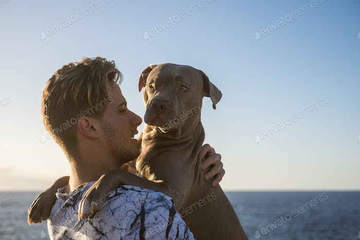 pure love concept image hugging and carrying with tenderness best friend dog