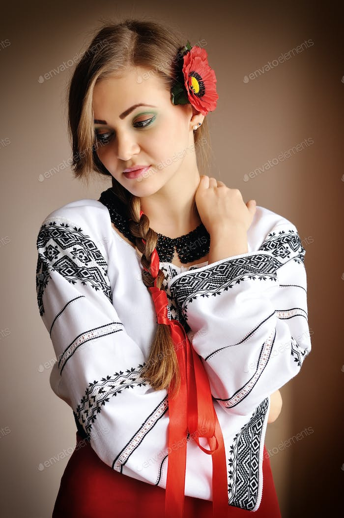 Beautiful young girl in a white embroidered blouse. Girl in Ukra